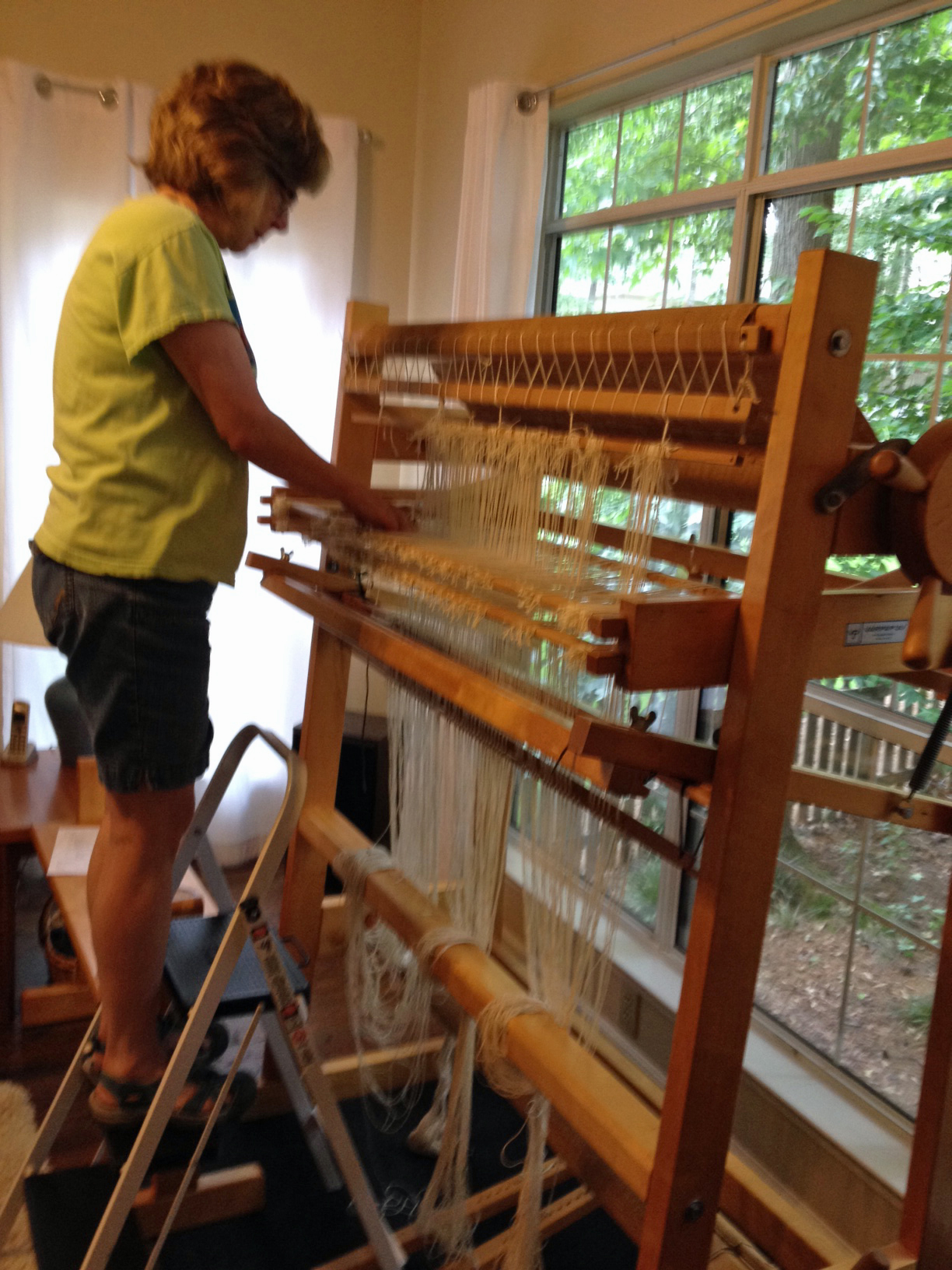 Molly warping Varpa loom